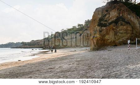 Fishermen On Beach Praia Falesia Near Albufeira