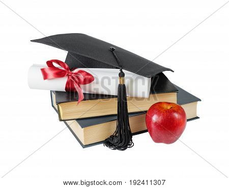 Concept of education: black graduate hat stack of big books red apple and paper scroll tied with red ribbon with a bow isolated on white background