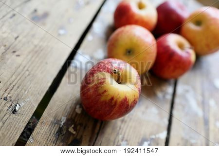 Red apples on a wooden background. Dietary low-calorie food.