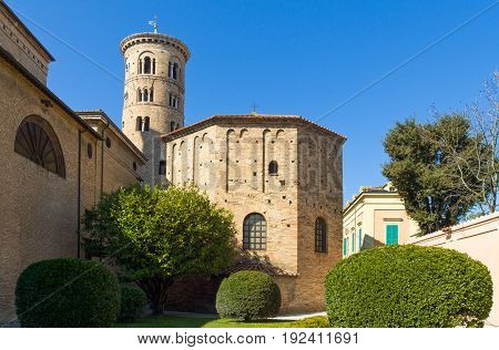 Italy Ravenna the Battistero Degli Ortodossi (or Neoniano) and in the background the Cathedral bell tower.