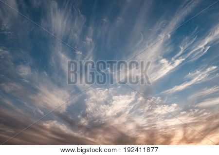 Dramatic Sky At Sunset, The Contrast Of Cirrus Cloud Shapes,