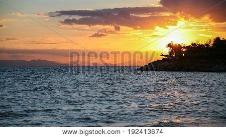 Yellow Sunset On Saronic Gulf Of Aegean Sea