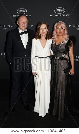 Isabelle Huppert, Francois-Henri Pinault, Salma Hayek at the Women in Motion Awards Dinner  for at the 70th Festival de Cannes.May 21, 2017 Cannes, France