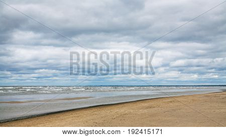 Low Gray Clouds Over Beach Of Baltic Sea In Autumn