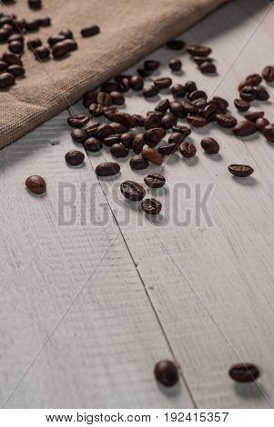 Coffee Beans On Sackcloth Background,