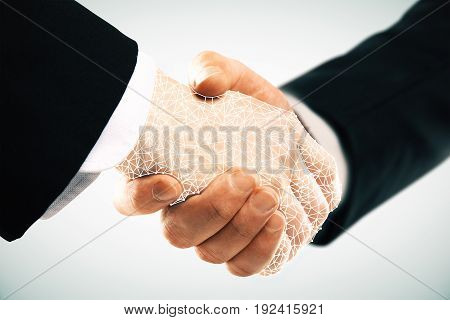 Abstract polygonal handshake on light background. Teamwork concept