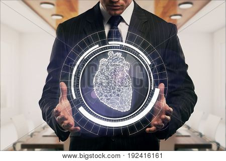 Businessman holding abstract digital circle with polygonal heart in interior. Cardio concept. 3D Rendering