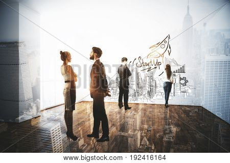 Businessmen and women communicating and drawing business sketch on wall of interior with city view. Entrepreneurs concept. Double exposure