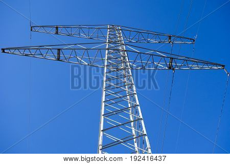 A post of light under a blue sky