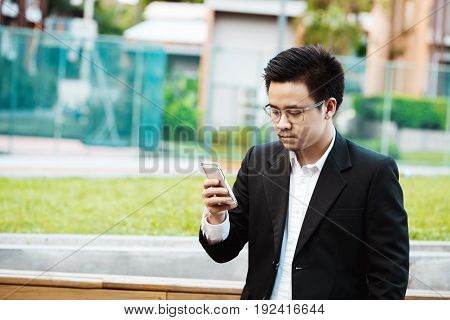 Concept Business - Business Man Serious With His Project On His Mobile Phone.