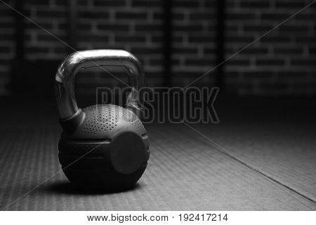 Kettlebell weights in a workout gym in black and white. Sport background. Copy space.