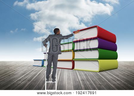 Digital composite of Business man on a ladder against books