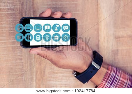 Digital composite of Hand showing mobile phone with icons