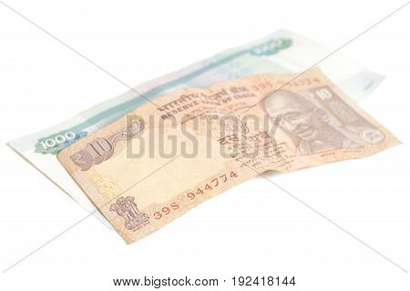 One thousand russian rubles and ten Indian rupees isolated on white