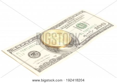 Golden bitcoin coin on us dollars isolated on white