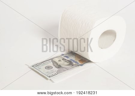 Toilet paper roll of money one hundred dollar isolated on white