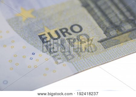 New five euro banknote on white .