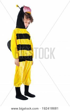 A small offended boy in a bee costume. White background.