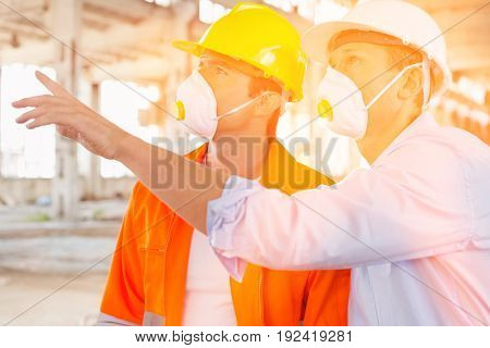 Male construction workers having a discussion at site