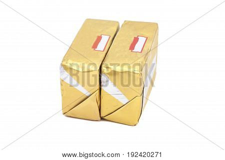 wrapped butter sticks isolated on white background