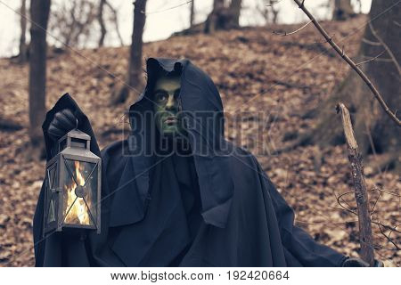 the green witch in the autumn forest