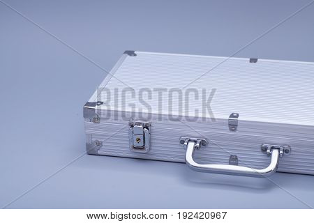 Metal silver case on gray background .