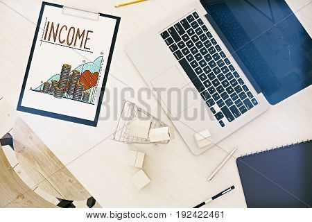 Top view of wooden desktop with empty laptop shopping cart and clipboard with business chart. Income concept. 3D Rendering