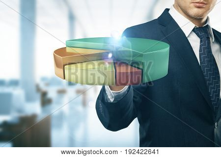Businessman drawing abstract transparent business diagram in blurry office interior. Finance concept. 3D Rendering