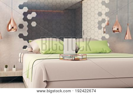 Creative tray with empty banner coffee cup and book placed on clean bed in modern interior with hexagonal mirror. Mock up 3D Rendering