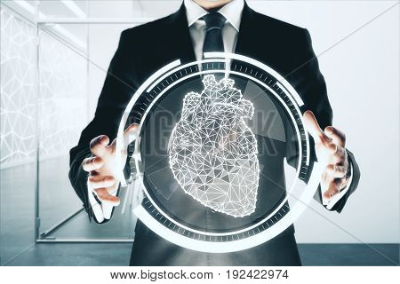 Businessman holding abstract digital circle with polygonal heart in interior. Medicine concept. 3D Rendering