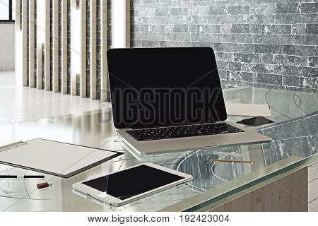 Close up of empty laptop tablet and paperwork placed on glass table in modern interior with daylight. Mock up 3D Rendering