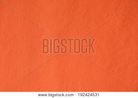The cement walls painted orange of the house was built.