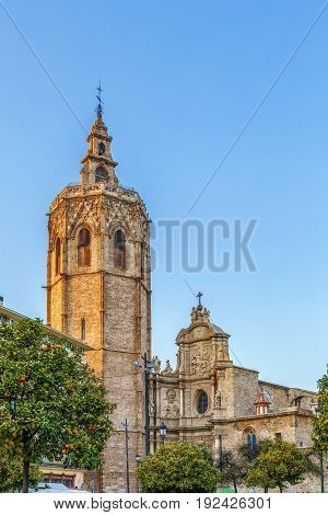 View of Valencia Cathedral or Basilica of the Assumption of Our Lady of Valencia from Plaza de la Reina Spain