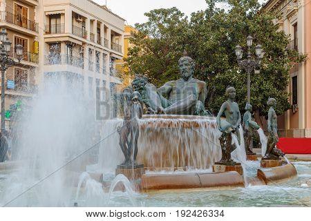 Turia Fountain with bronze statue of the Roman god Neptune in Valencia Spain