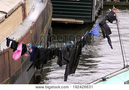 Washed clothes drying in the sun on the boathouse in Amsterdam, Netherlands