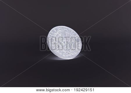 Happy coin for good luck, on a homogeneous background.