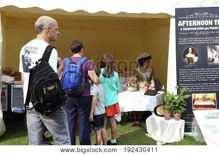 LONDON, GREAT BRITAIN - SEPTEMBER 7, 2014: It's the line to the tent for traditional English aftenoon tea at Thames Festival in Victoria Embankment Gardens.