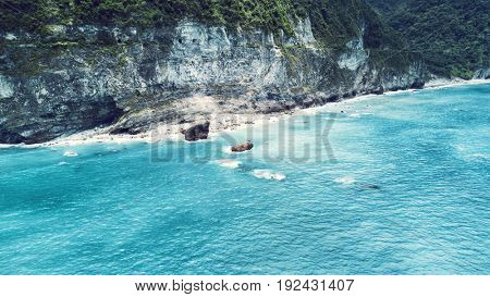 Aerial view of Qingshui Cliff surrounded by turquoise sea. Taiwan 2017