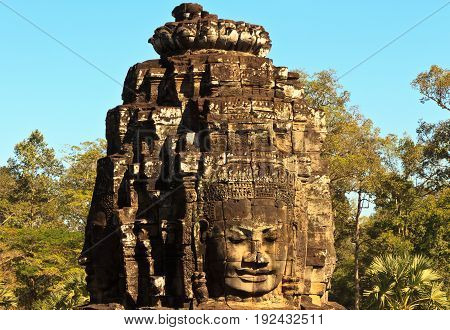 Ancient stone face of Bayon temple, Angkor, Cambodia