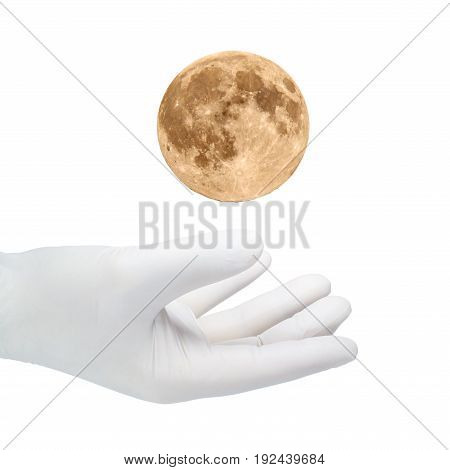 A hand in a white glove catches the moons.