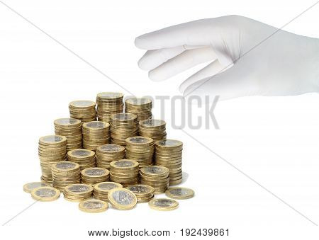 A hand in a white glove grabs a stack of euro coins.