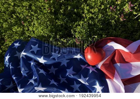 American flag and heart on the ground