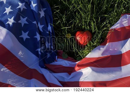 American flag and red heart on the ground