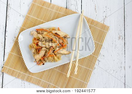 Chapchae - Asian Dish Of Glass Noodles With Chicken And Vegetabl