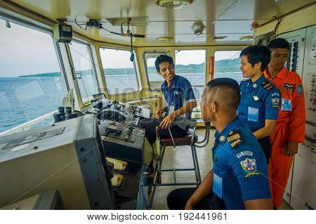 BALI, INDONESIA - APRIL 05, 2017: Ferry boat pilot command cabin with view on the sea with many assistants there in Ubud, Bali Indonesia.