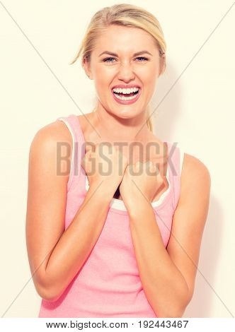 Young woman in a boxing pose on a white background