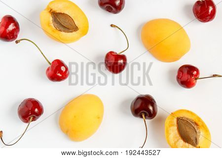 Cherry and apricot on a white background. Flat lay.