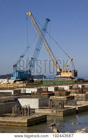Two cranes working on construction of new dock in Dubrovnik harbor