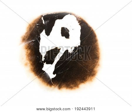 Trail of burnt paper on white background .