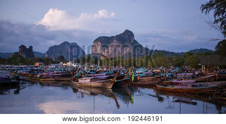 Longtail boats on sunrise in port Ao Nang. Thailand